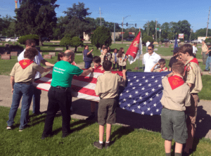 Troop 32 participate in placing flags to honor US Veterans