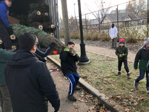 Read more about the article Troop 32 Unloads Christmas Trees with The Lions Club