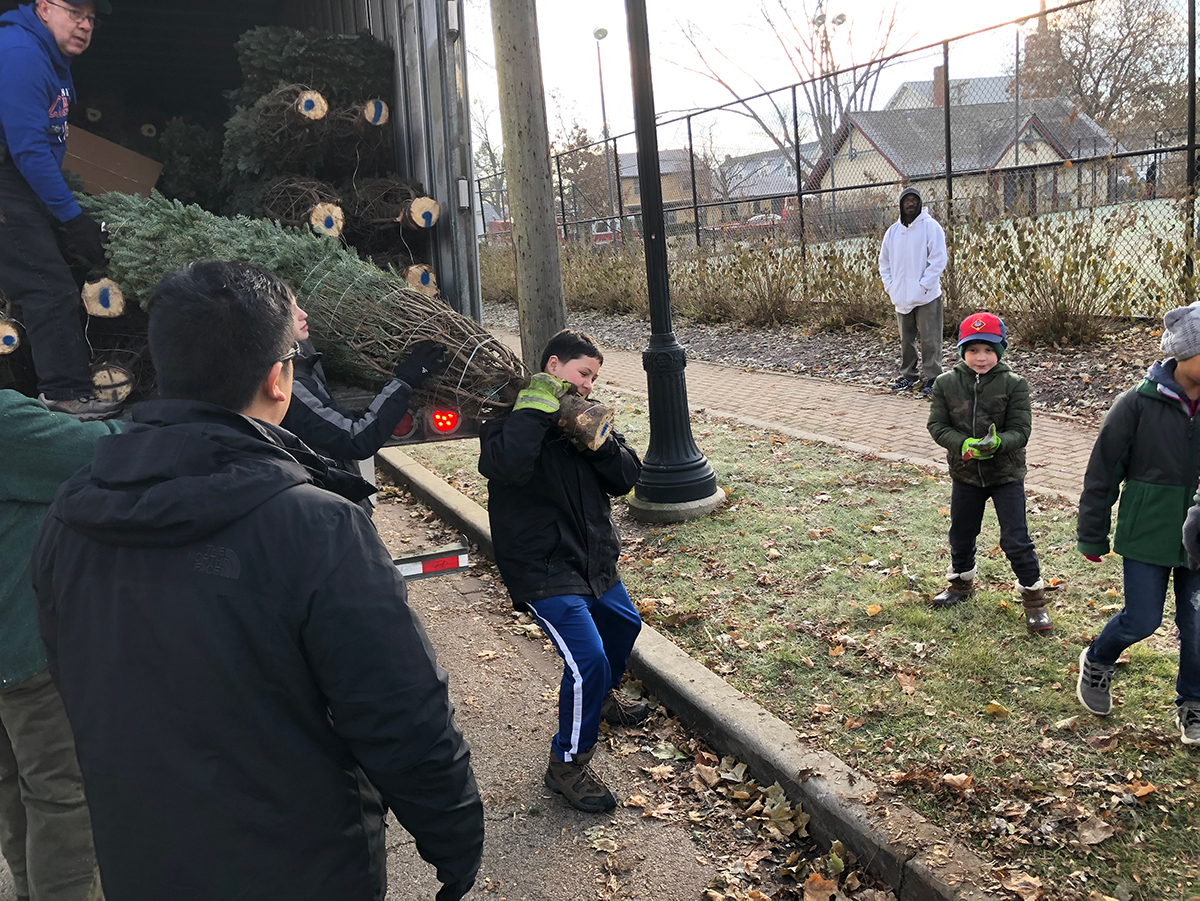 Troop 32 Unloads Christmas Trees with The Lions Club